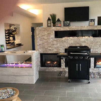 Thermotane Propane showroom with a grill and fireplaces