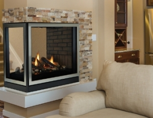 A multi-sided fireplace next to a couch